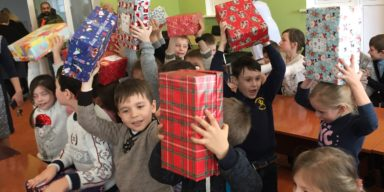 Boys in Moldova holding Teams4U shoeboxes