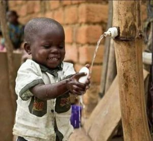 Young boy washing his hands with soap