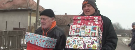 Dave Cooke and Ian Mackenzie carrying shoeboxes